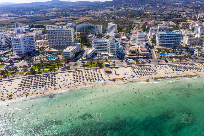 August 23, 2019: Spain- Balearic Islands- Cala Bona- Aerial view of resort town and crowded beach in summer