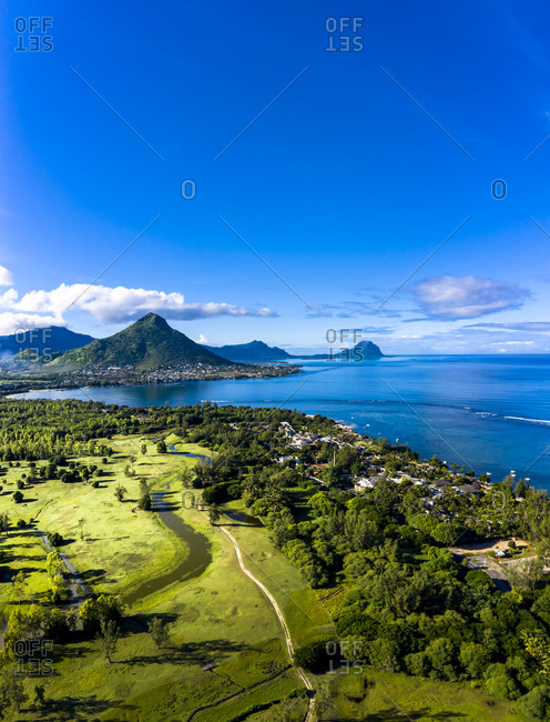 Mauritius- Black River- Flic-en-Flac- Aerial view of blue sky over coastal village in summer with Tourelle du Tamarin mountain in distant background