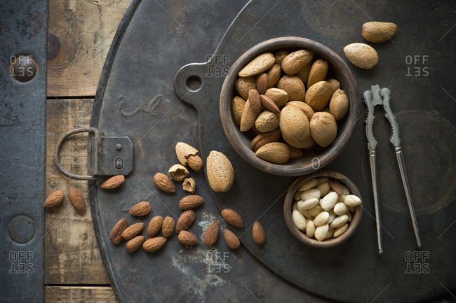Old-fashionednutcracker and bowls of almonds