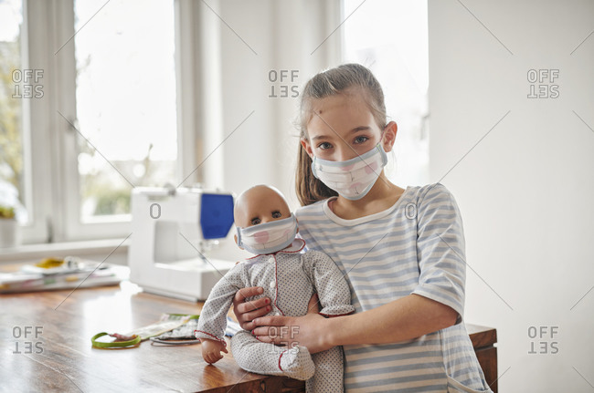 Little girl and her doll- wearing self-made face masks