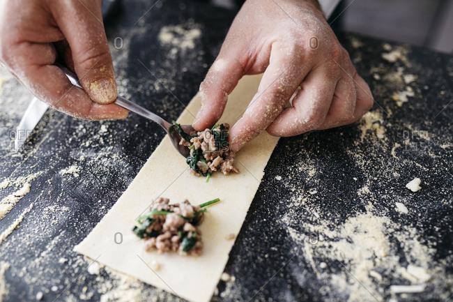 Close-up of man preparing homemade gluten free pasta