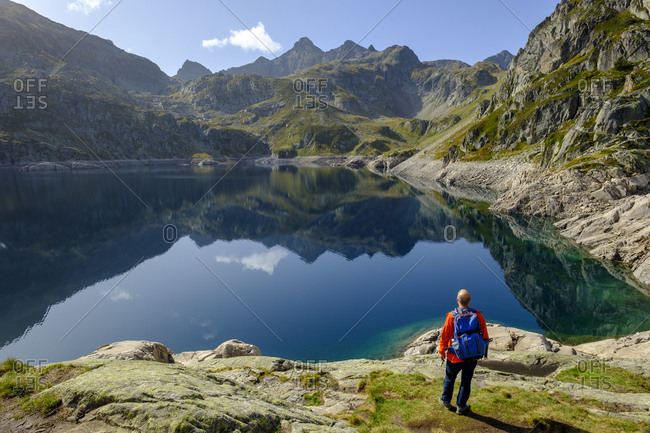 France- Pyrenees-Atlantiques- Laruns- Lone hiker at Lac dArtouste in Ossau Valley
