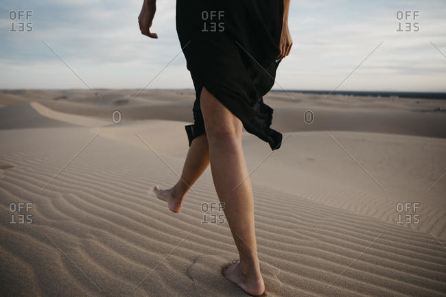 Crop view of woman walking barefoot on sand dune- Algodones Dunes- Brawley- USA