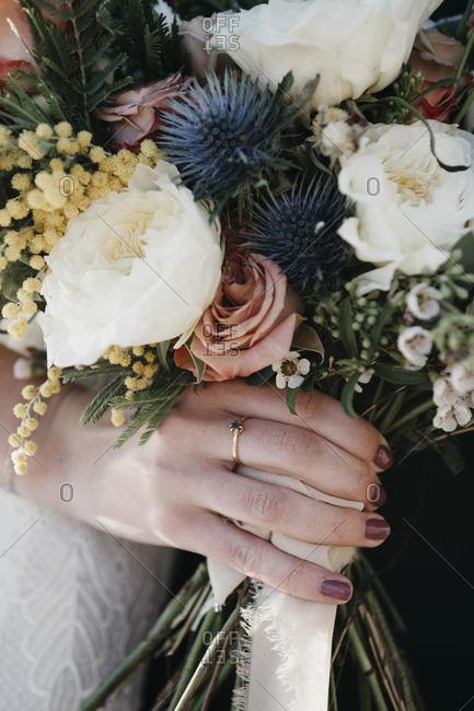Bridal couple with bridal bouquet