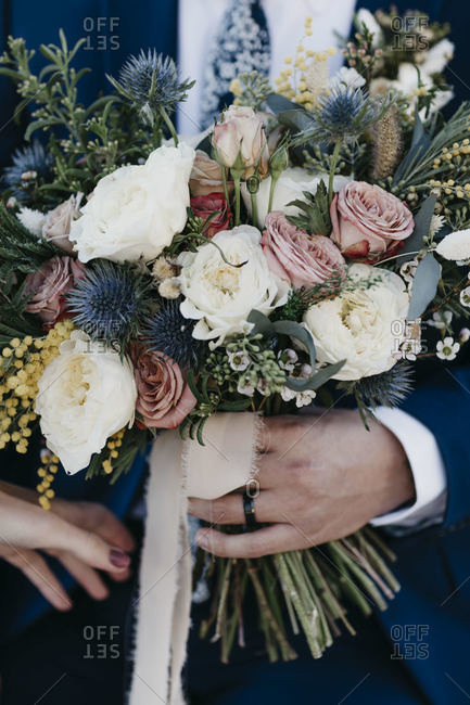 Bridal couple with bridal bouquet