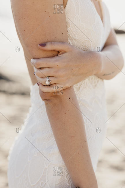 Ring of a bride wearing white wedding dress