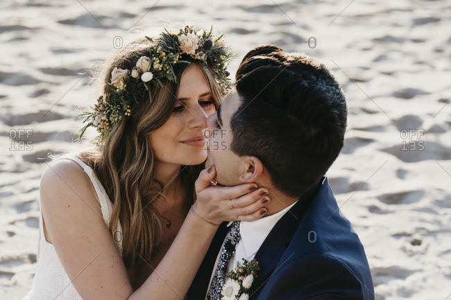 Happy bridal couple kissing each other