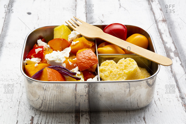 Lunch box with autumn oven baked vegetables- feta cheese and heart shaped polenta