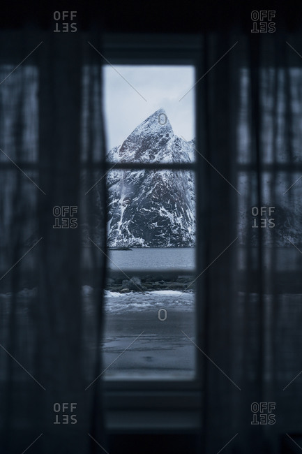 View out of window to coastal landscape with mountain- Lofoten- Norway