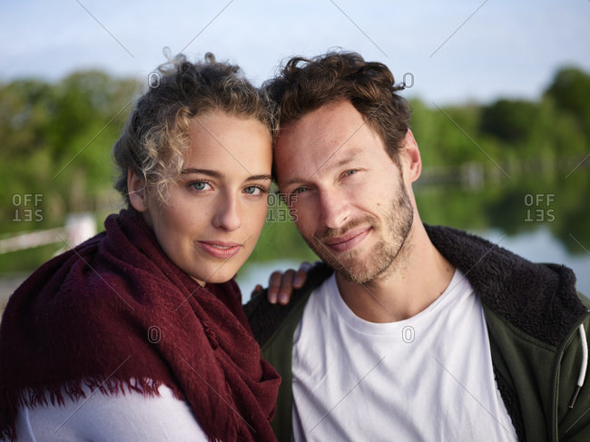 Portrait of romantic couple at lake