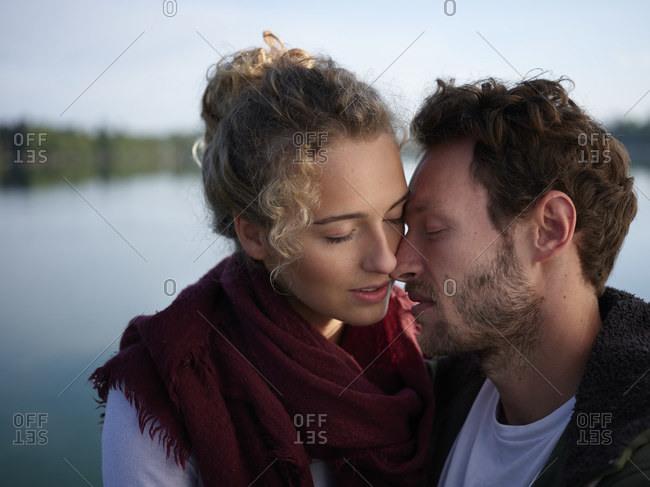 Romantic couple kissing at lake