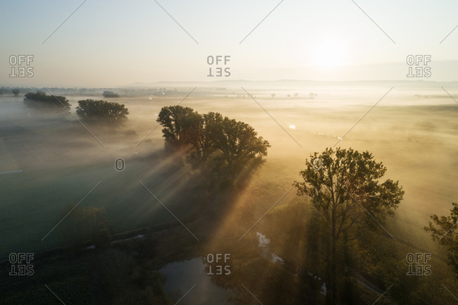 Germany- Bavaria- Drone view of countryside landscape at foggy sunrise