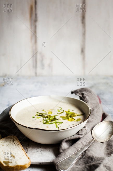 Bowl of cheese soup with bell pepper- leek and minced meat