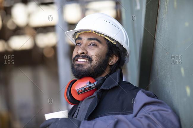 Technician wearing helmet and beard- during break
