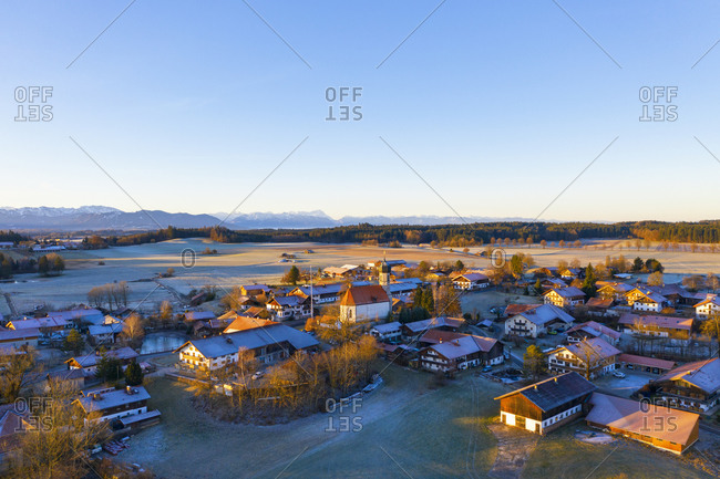 Germany- Bavaria- Lochen- Drone view of clear sky over countryside village at dawn