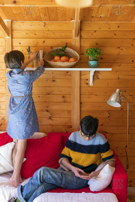 Mother and daughter preparing countryside property to welcome guests