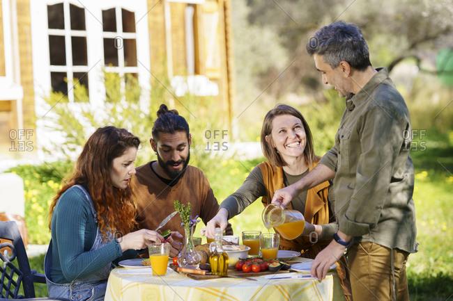 Friends enjoying a healthy vegan breakfast in the countryside