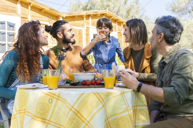 Finland friends enjoying a healthy vegan breakfast in the countryside