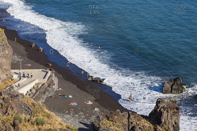 May 24, 2019: Portugal- Madeira- Funchal- People relaxing on beach of Atlantic Ocean in summer