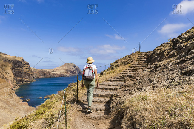 Portugal- Madeira- Female hiker walking up coastal steps at Ponta de Sao Lourenco