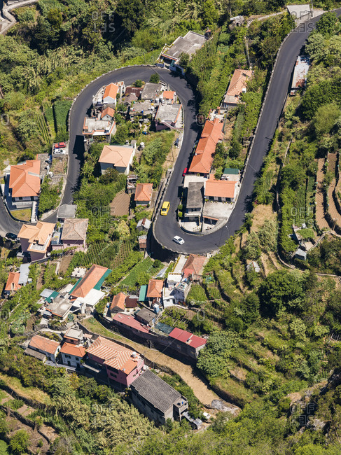 Portugal- Madeira- Curral das Freiras- High angle view of winding road stretching across mountain village