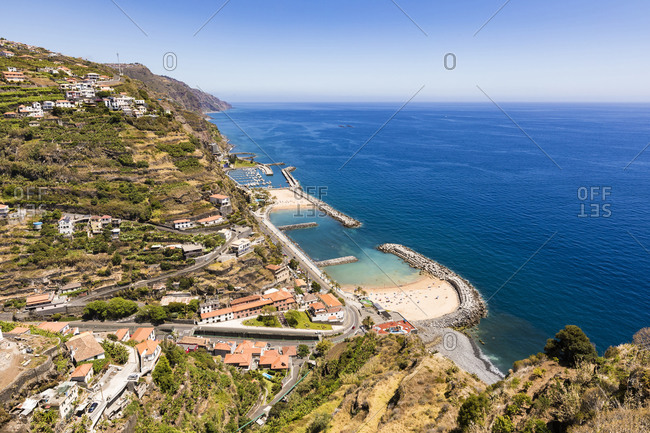 Portugal- Madeira- Calheta- High angle view of coastal town and artificial bay in summer