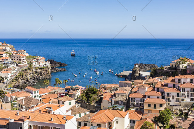 May 25, 2019: Portugal- Madeira- Camara de Lobos- Houses of coastal town with Atlantic Ocean in background