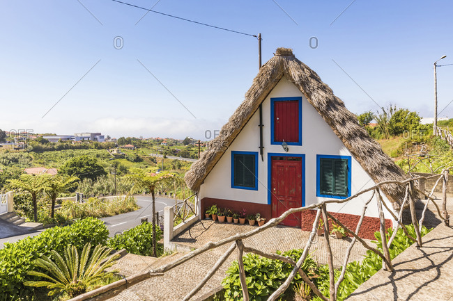 Portugal- Madeira- Santana- Facade of traditional triangle shaped town house with thatched roof