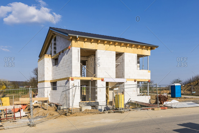 Germany- Baden-Wurttemberg- Waiblingen- Fence in front of modern house under construction
