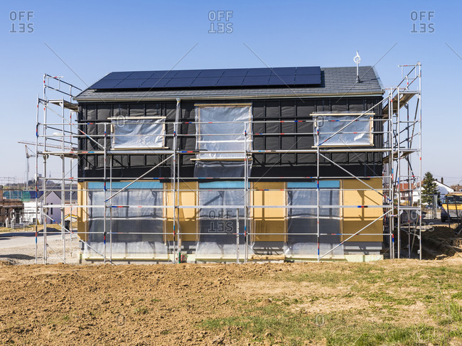 Germany- Baden-Wurttemberg- Waiblingen- Construction site of modern house equipped with solar panels