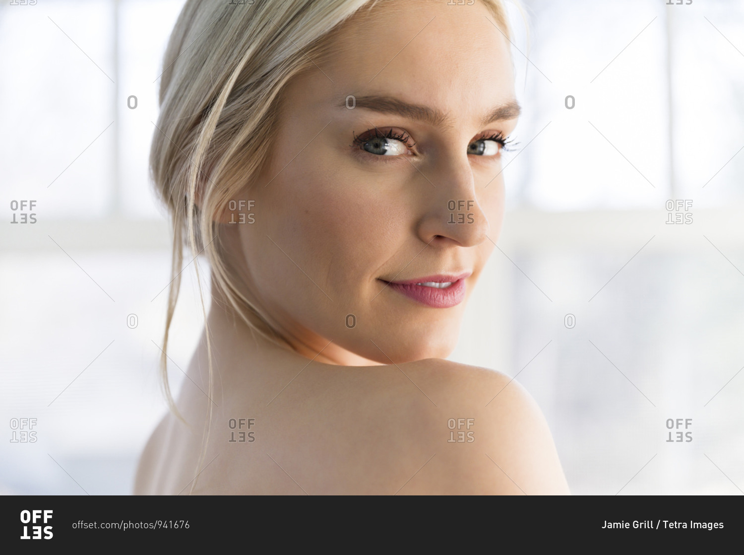 Portrait Young Woman Looking Over Naked Shoulder Stock