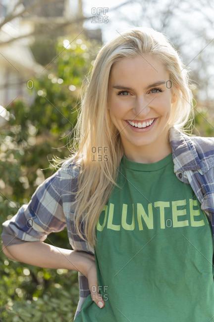 Portrait of smiling woman in volunteer t-shirt