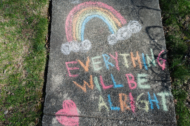 Hopeful message written on sidewalk in chalk during Covid 19 pandemic