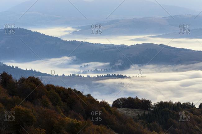 Ukraine, Zakarpattia region, Carpathians, Borzhava, Fog over mountain landscape