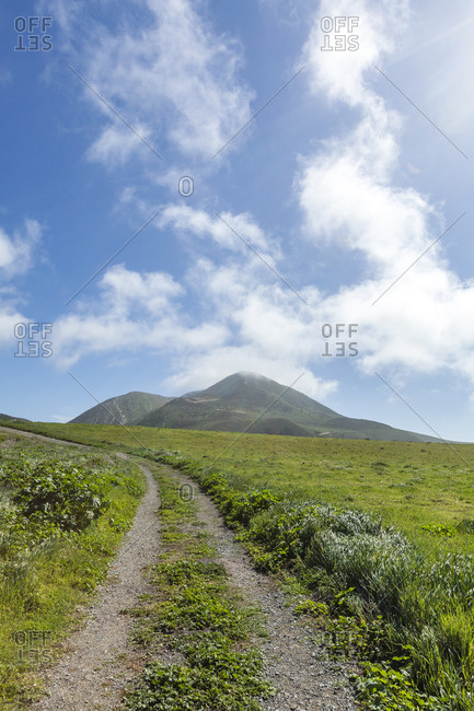 USA, California, San Luis Obispo, Dirt road under clouds