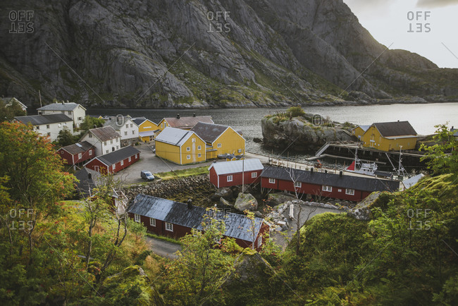 Norway, Lofoten Islands, Nusfjord, Scenic view of traditional fishing village with red houses