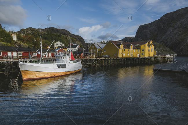 Norway, Lofoten Islands, Nusfjord - September 18, 2019: Fishing boat in dock in traditional fishing village
