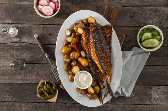 Healthy dinner with grilled mackerel, new potatoes and vegetable