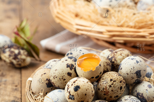Close-up open quail eggs on board.