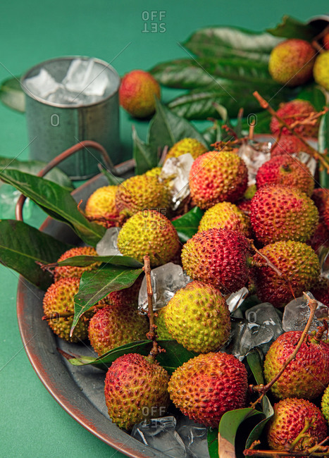 Close-up fresh lychee on green background.