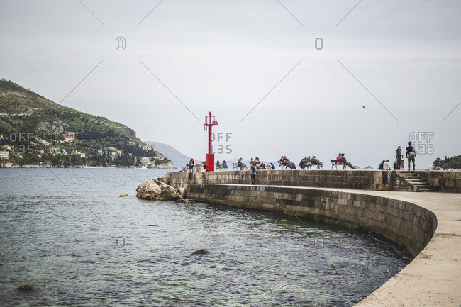 View of the lighthouse full of people in Dubrovnik
