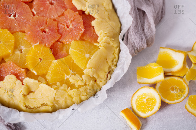 Uncooked citrus galette with orange and clementine slices
