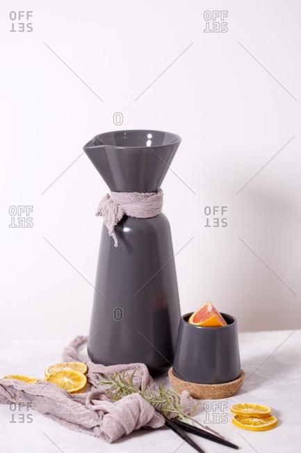 Orange tea prepared in gray teapot