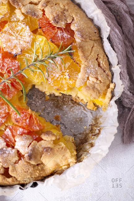 Baked orange galette missing slice top view