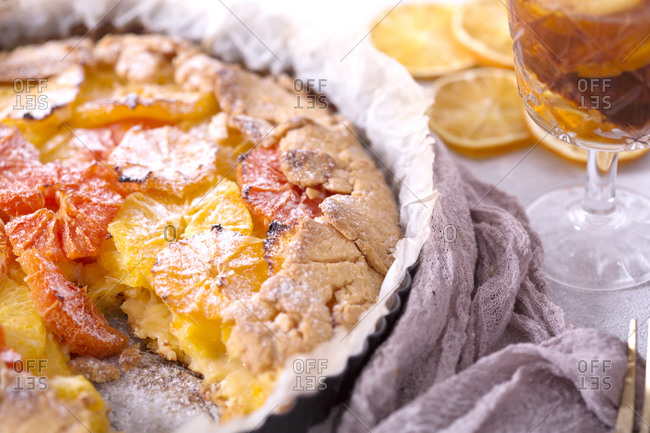 Baked orange galette with the tea on the table