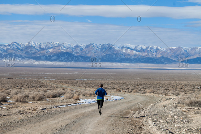 Rear view of man running in Colorado