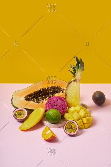 Still life with tropical fruits on colorful background