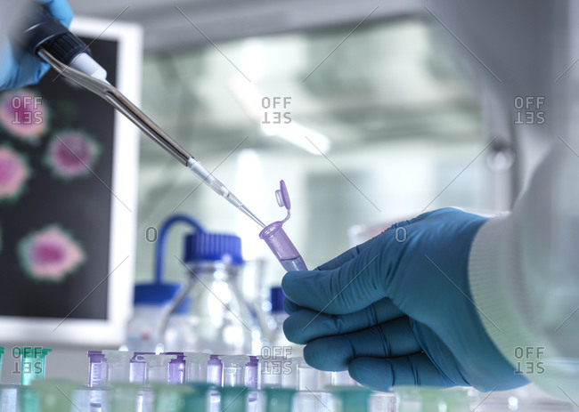 Pharmaceutical Research, Scientist preparing a sample vial for analytical testing in the laboratory used in DNA, medical and pharmacology research.