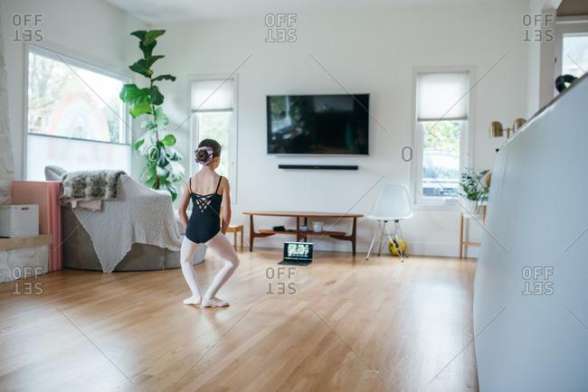 Girl virtually takes a ballet class at home