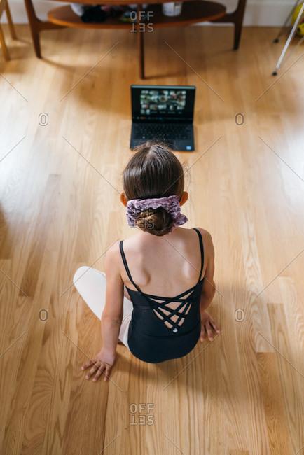 Girl watching a ballet class at home
